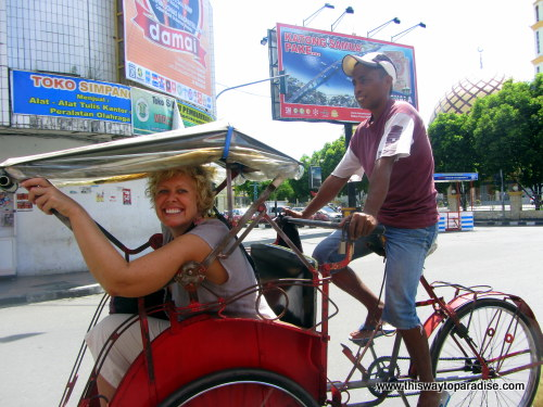 Val in a becak in Maluku, Indonesia