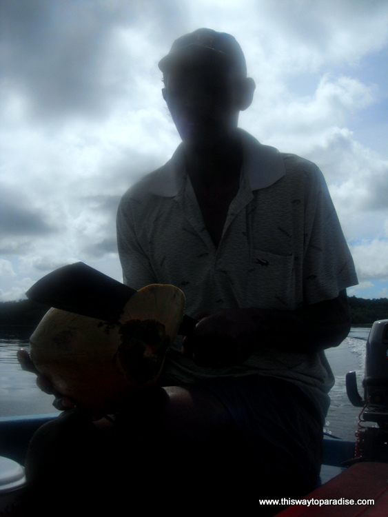 Man with a green coconut on Kai Island