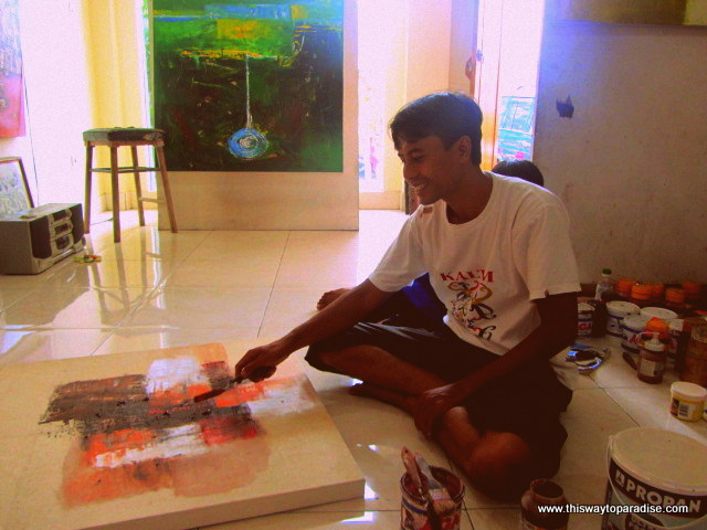 Nyoman teaching how to paint