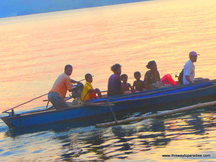 Boat filled with a family in Raja Ampat