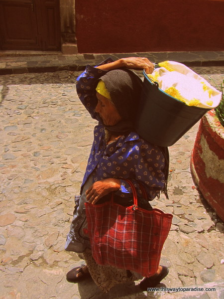 Woman carrying her laundry