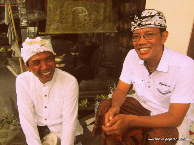 Balinese men sitting on sidewalk