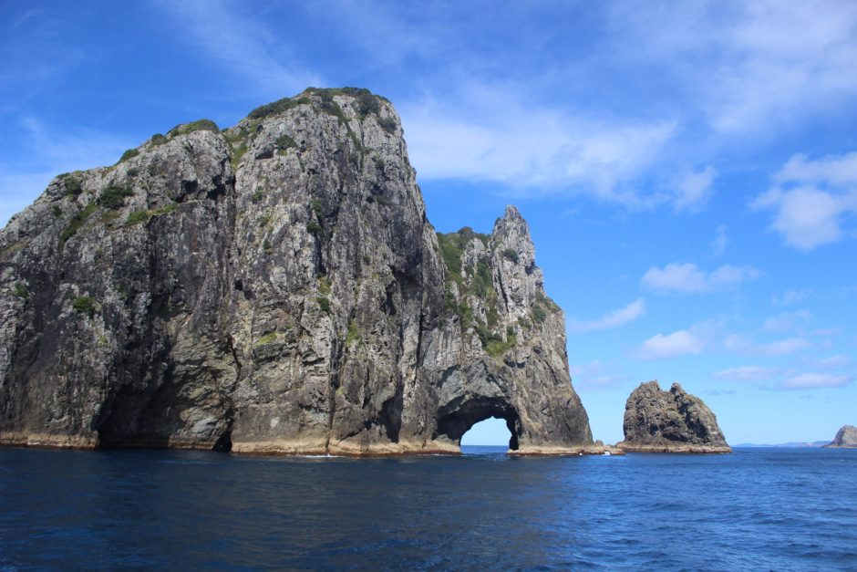 The Hole in the Rock, a natural sea arch in the Bay of Islands, New Zealand