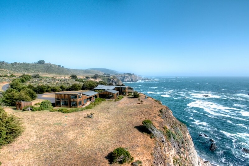 mendocino coastal home sea arches aerial shot
