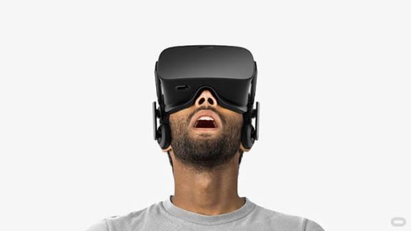 photo of man wearing oculus rift virtual reality headset
