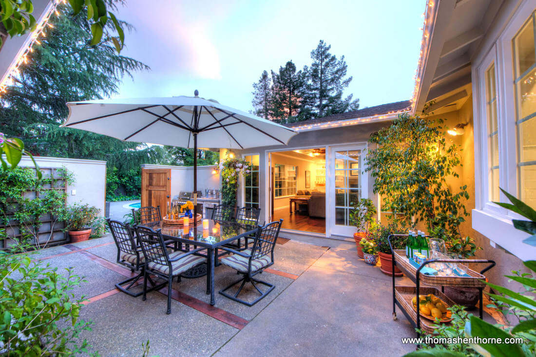 Outdoor Dining Area With Pool in Distance