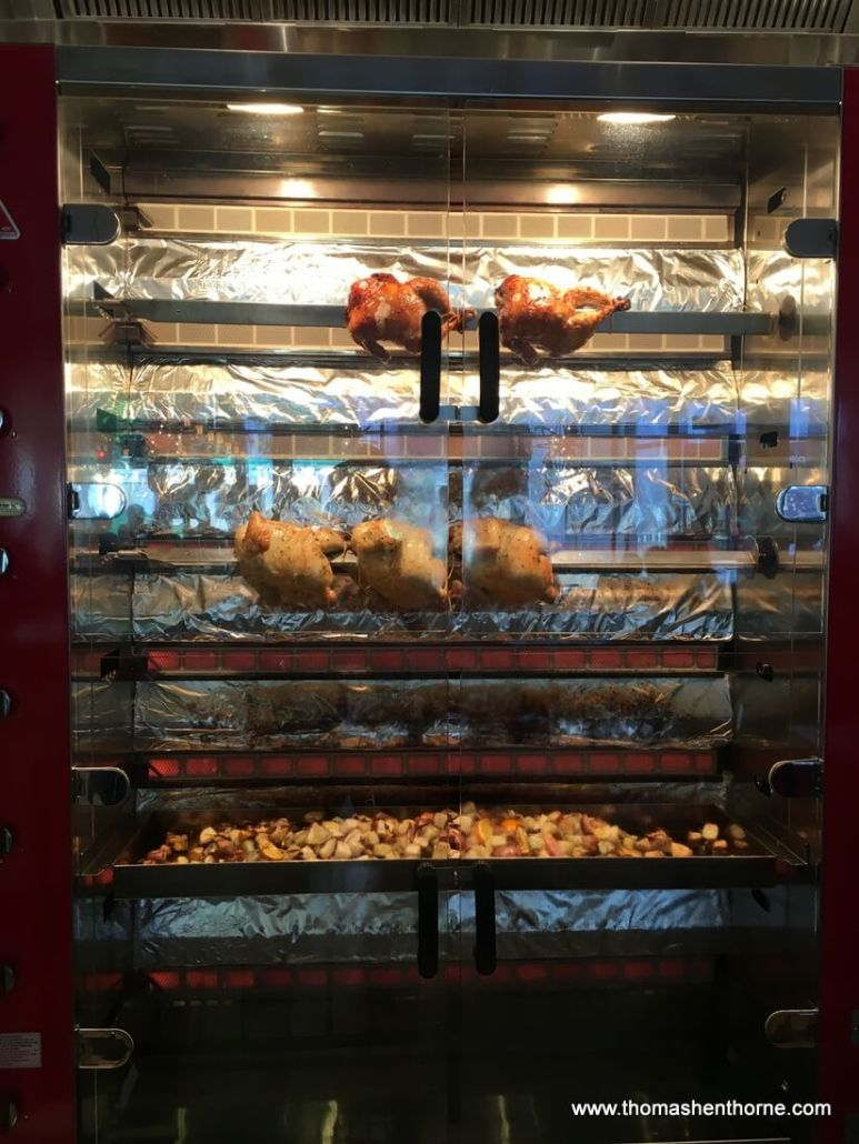 photo of rotisserie chicken dripping fat on potatoes