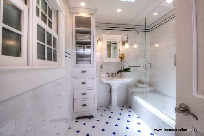 beautiful bathroom with glass shower surround and white tile