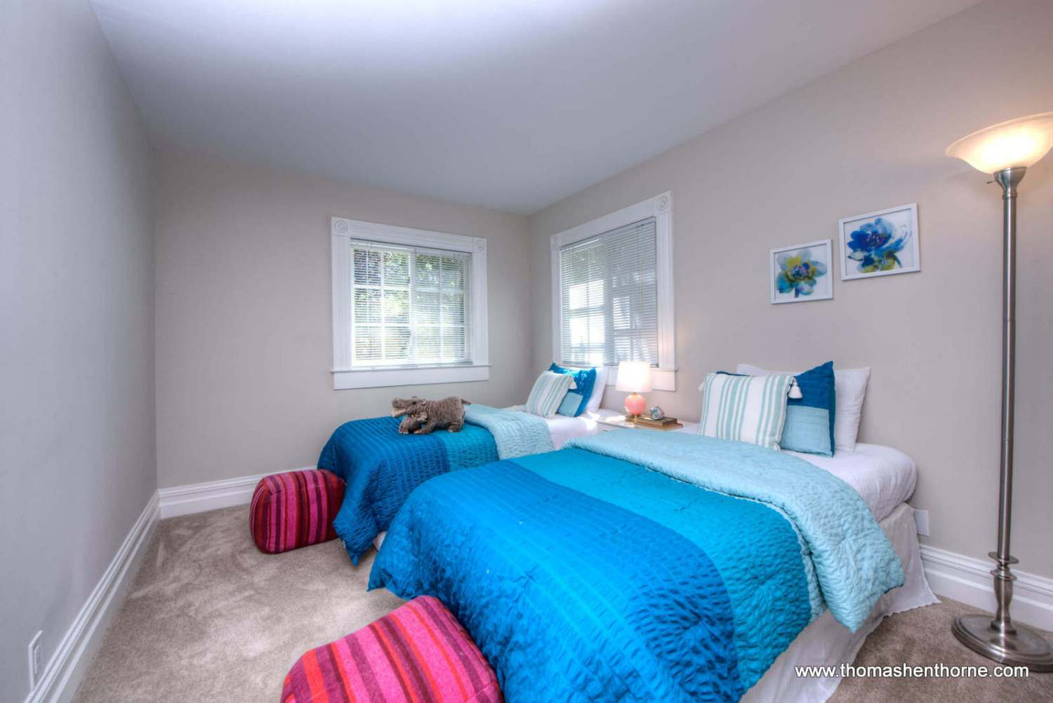 photo of bedroom with blue bedspreads and two beds