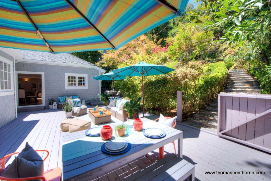 striped colorful patio umbrellas and table