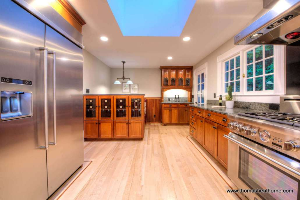 chef's kitchen with stove on right and refrigerator on left stainless