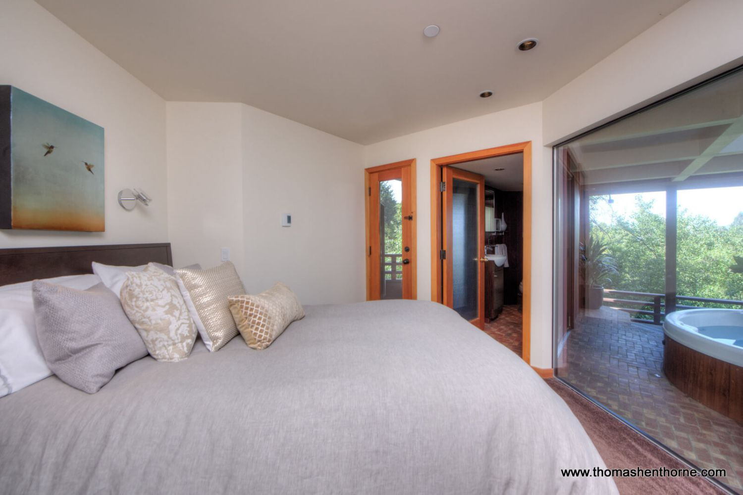 master bedroom photo with hot tub deck at right