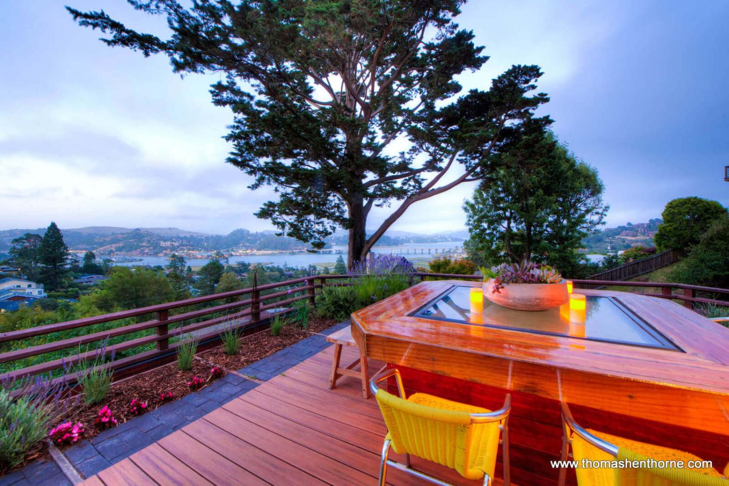 Photo of outdoor table with bay in background