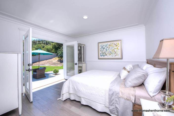 Bedroom with open French doors out to patio