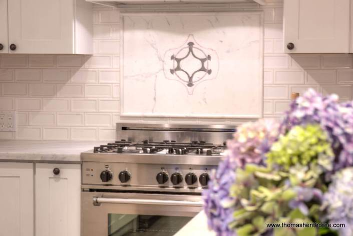 Range stove with hydrangeas in foreground