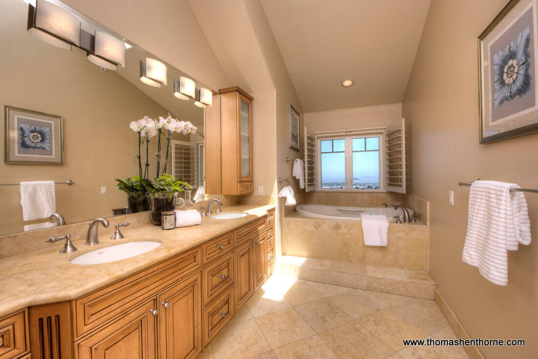 Photo of master bathroom with double sinks and view tub