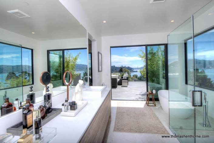 master bathroom with door opening on to terrace