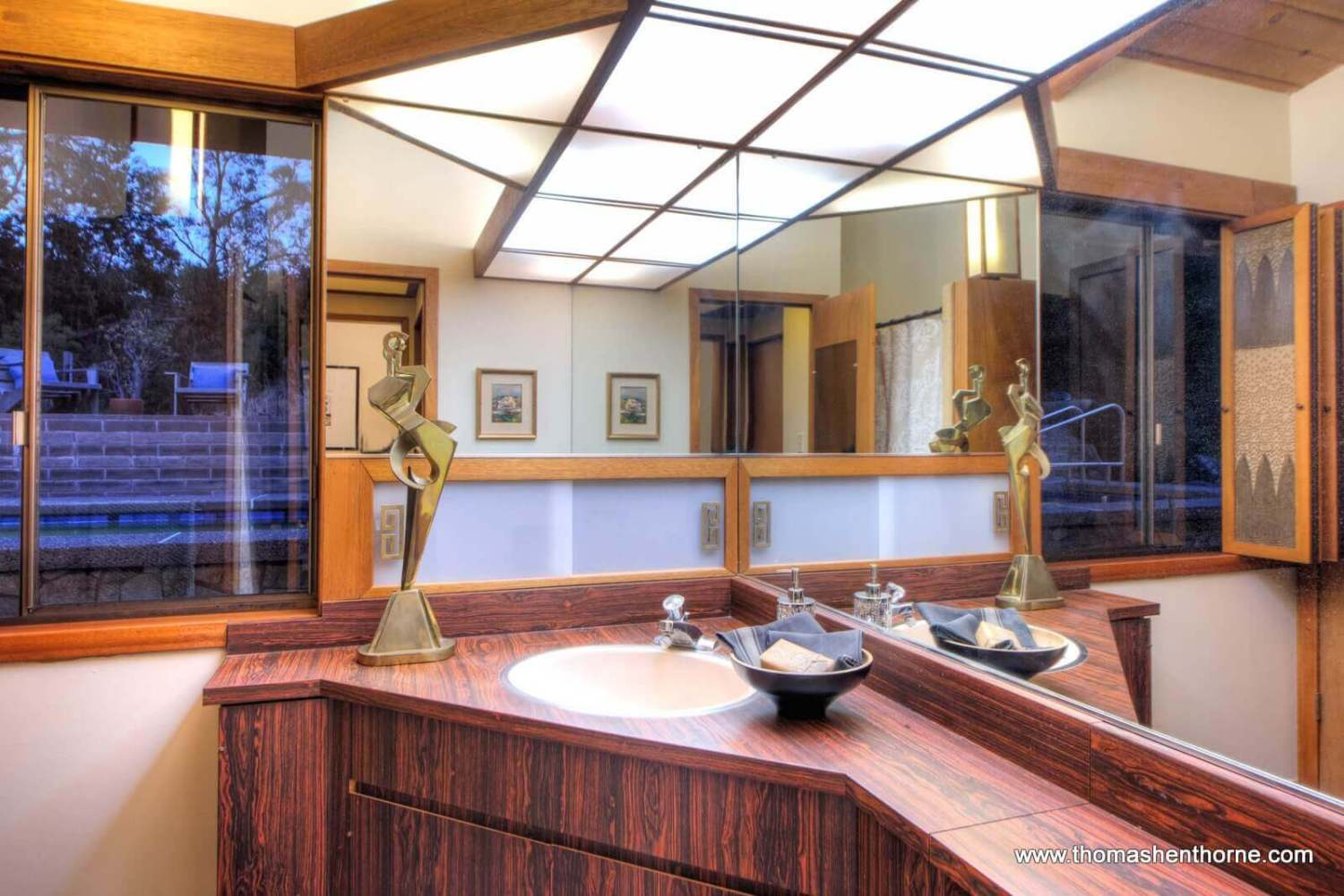 bathroom with view of pool