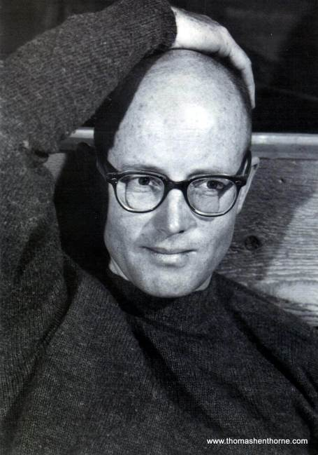 Mark Mills wearing glasses with hand on his head