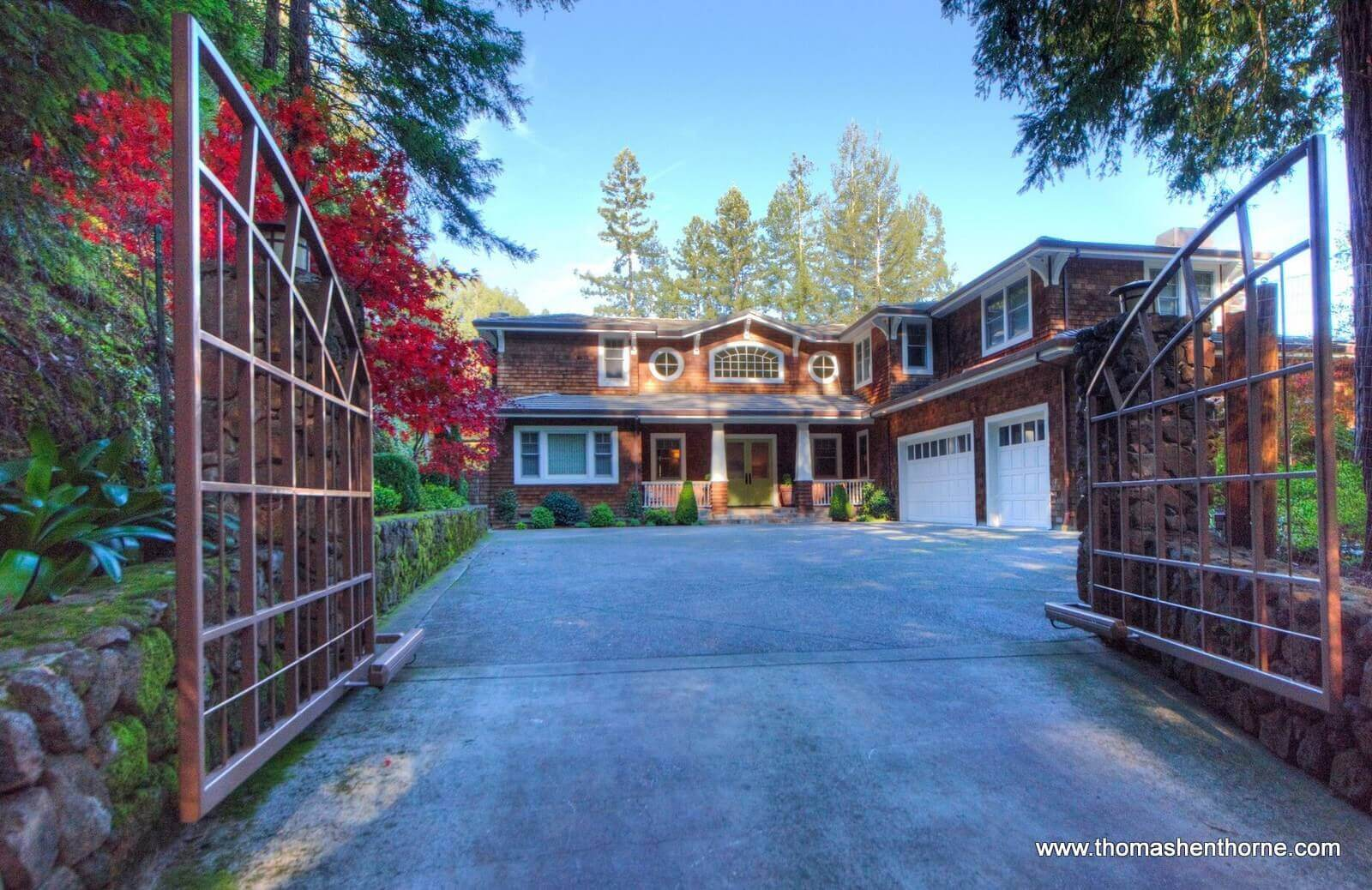 8 Woodland Place front entry gate and home with brown shingles and white trim