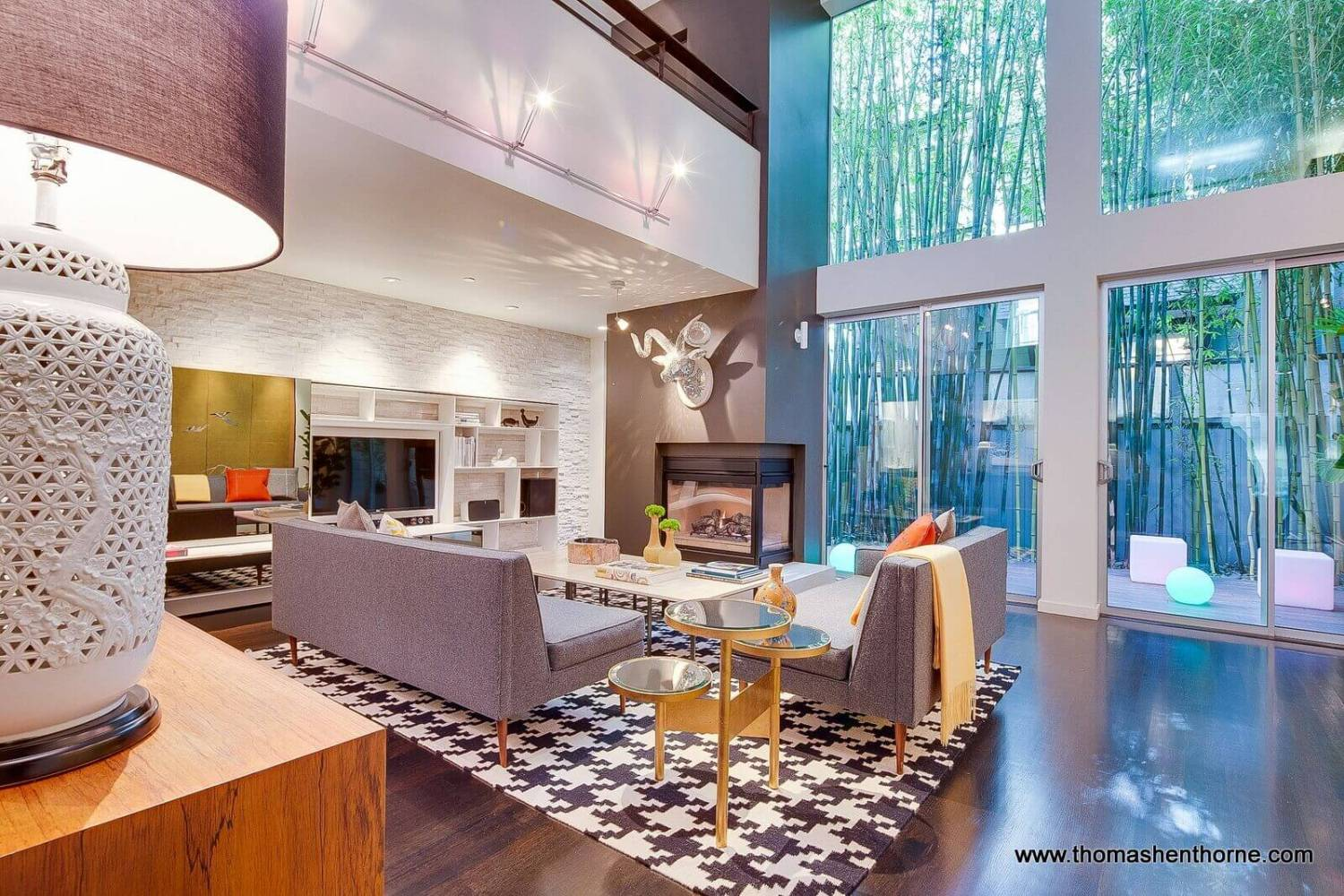 124 Lily Street San Francisco Living Room with fireplace and deck beyond glass doors