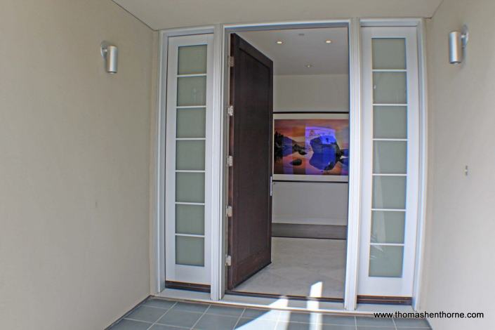Front entry door with art in background