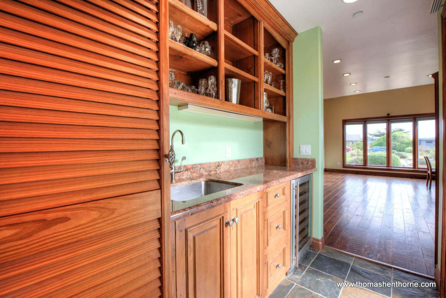 Butler's pantry with granite counter top