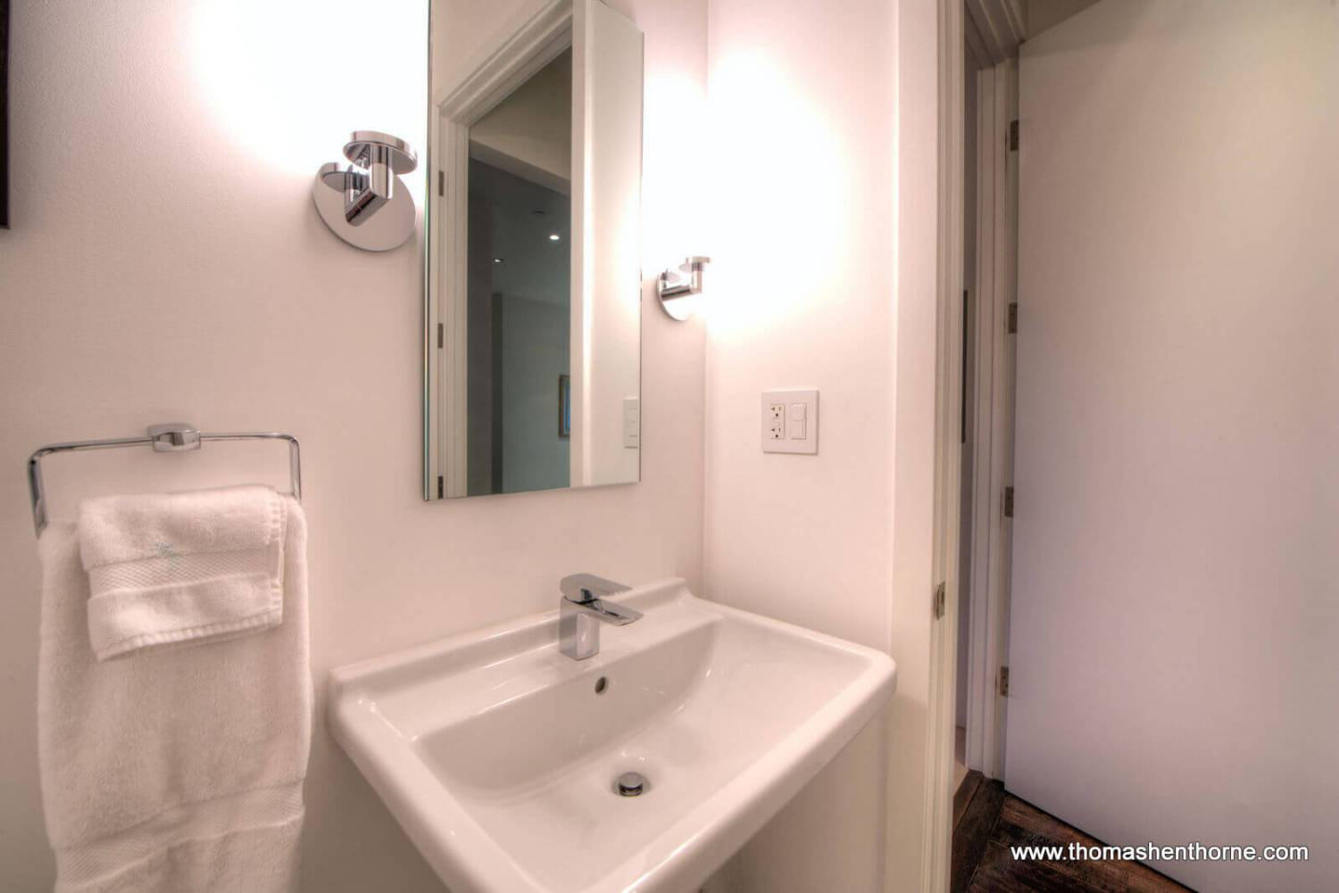 sink and towels with mirror