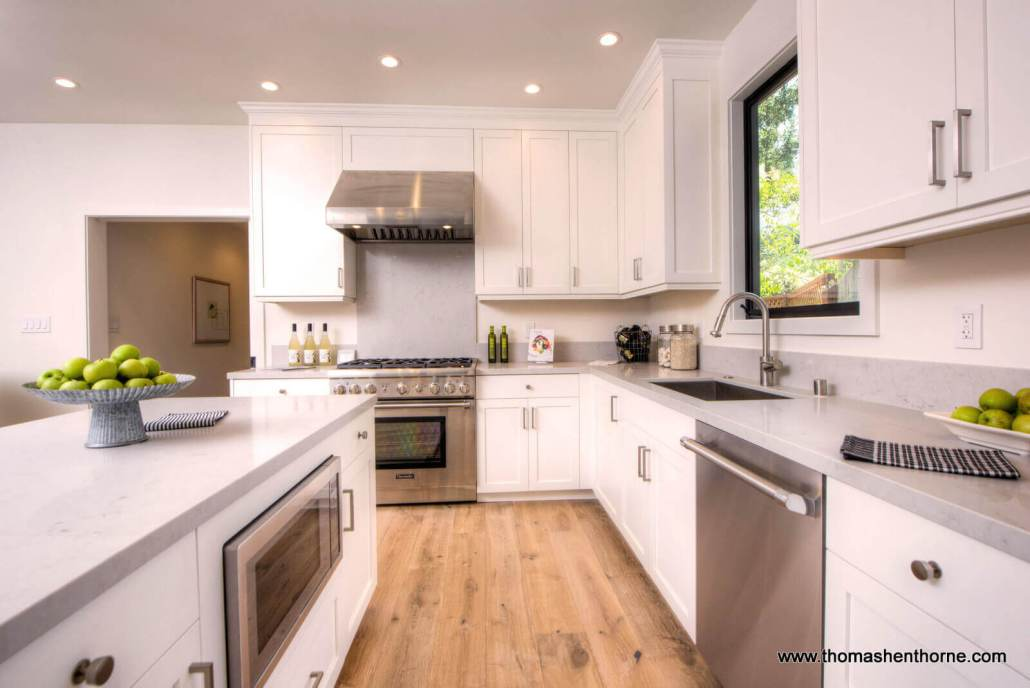 kitchen with stainless appliances and caesarstone countertop