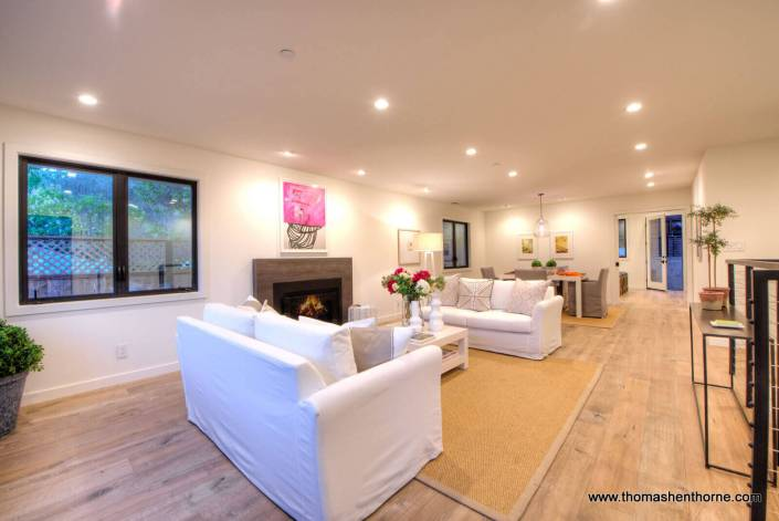Living room and dining room with wide plank flooring throughout