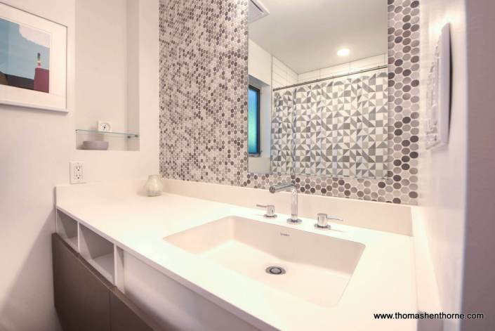 master vanity with mirror and tile
