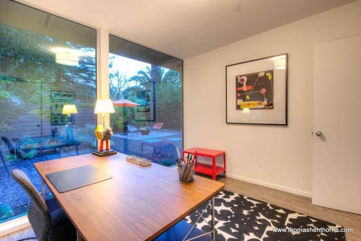 office with backyard through windows