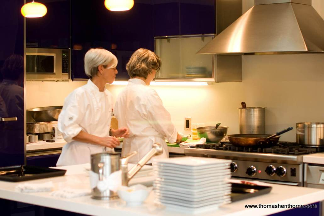 Caterers working in kitchen