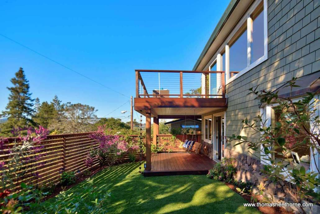 Shingled home with two decks and flat lawn area