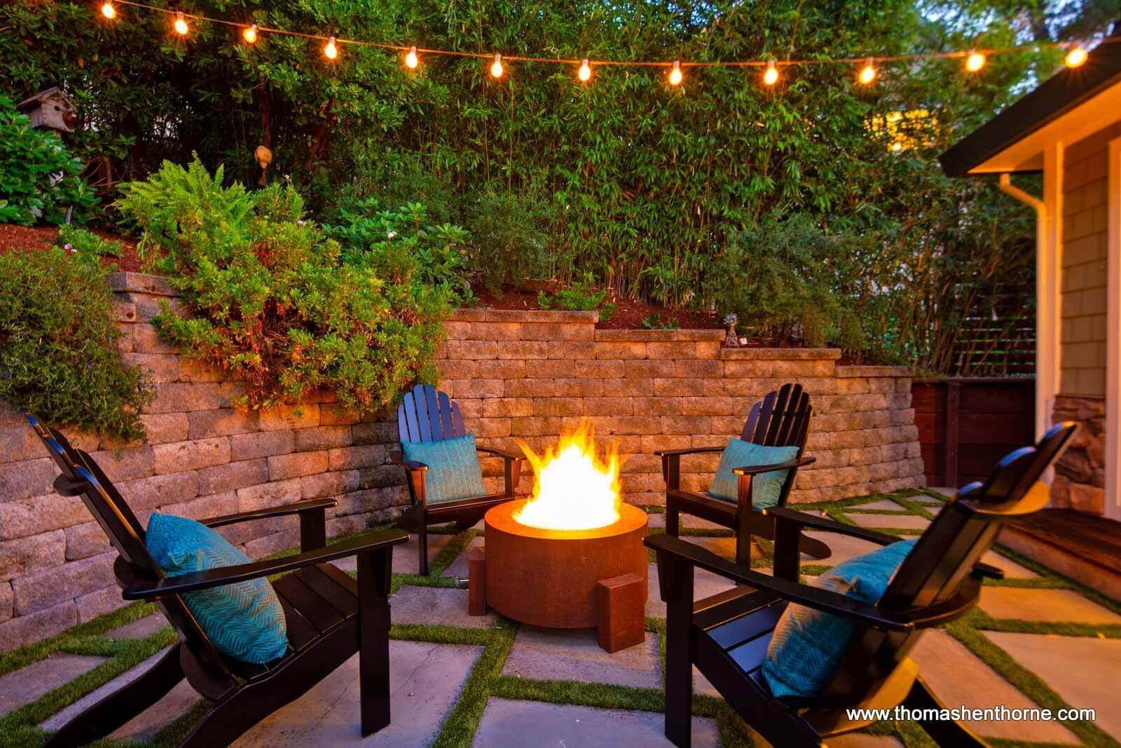 Fire Pit with Adirondack chairs surrounding