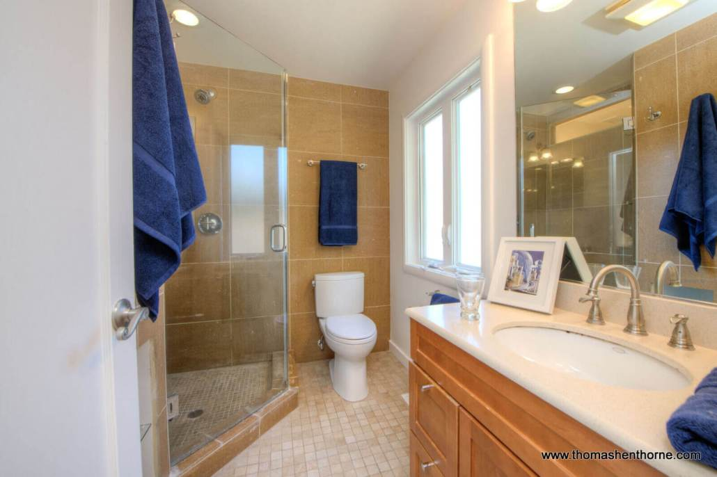 Bathroom with sink and shower with glass shower enclosure