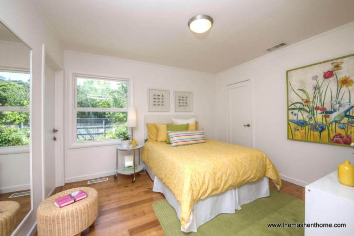 Bedroom with bed with yellow comforter