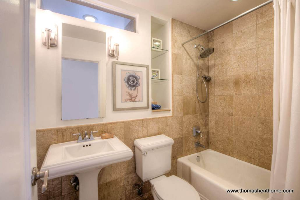 Bathroom with pedestal sink tub and toilet