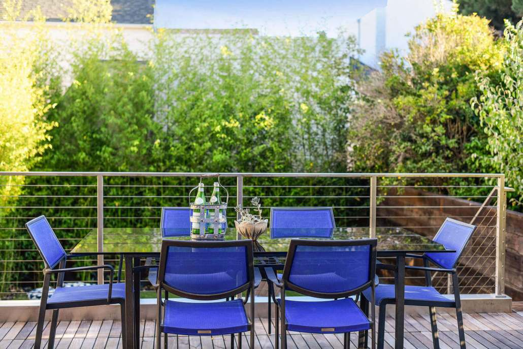 Modern outdoor table with blue chairs