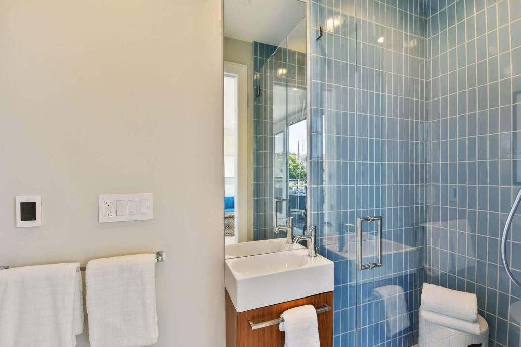 Stall shower and modern vanity