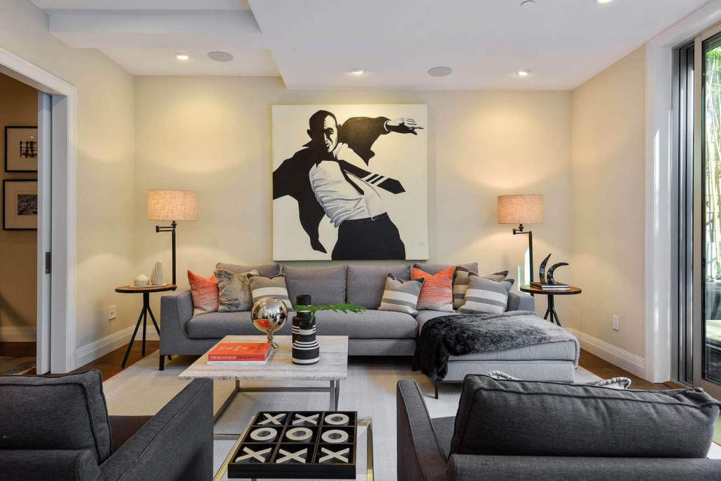 Modern furniture in living room with large contemporary art