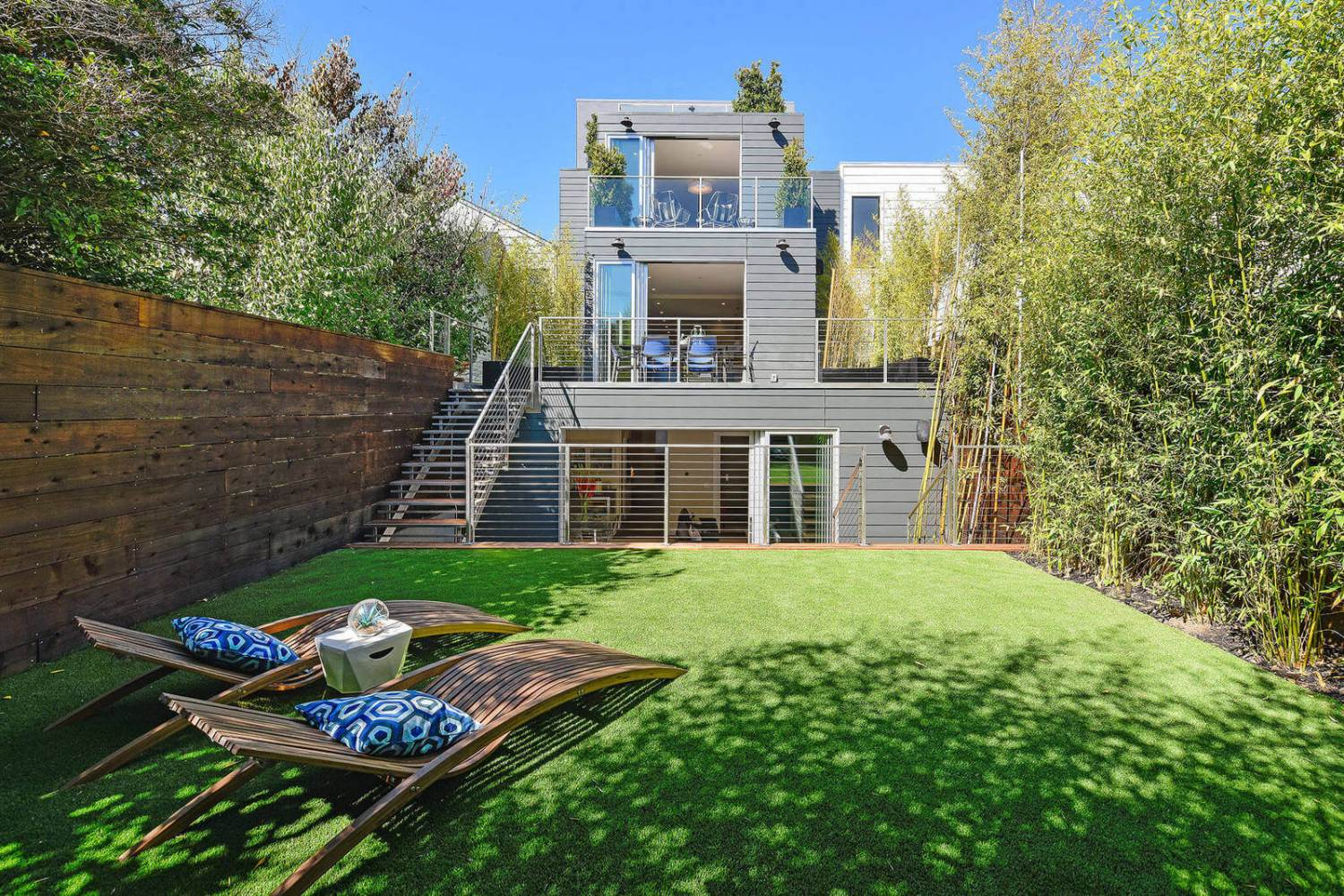 Modern home with backyard and decks with cable railings