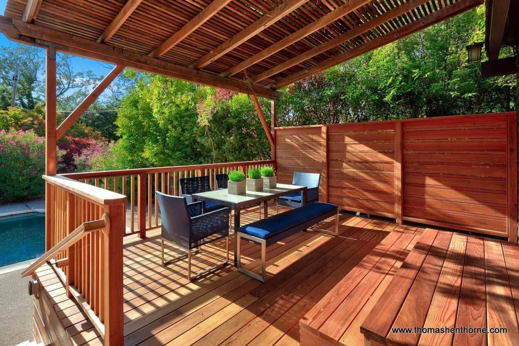 Outdoor dining table and chairs on large deck