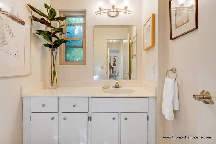 Bathroom with single sink and vanity