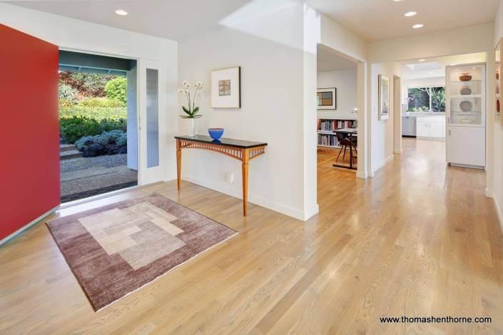 hallway with wood floors off front door