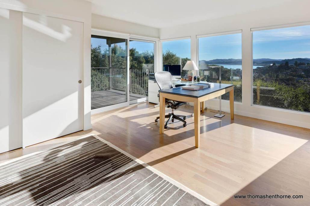 Office with hardwood floors in home