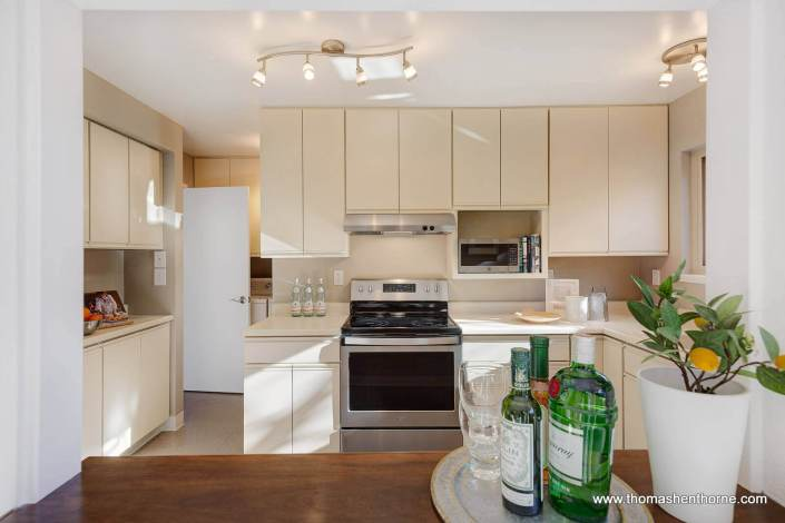 kitchen with stainless appliances and laundry