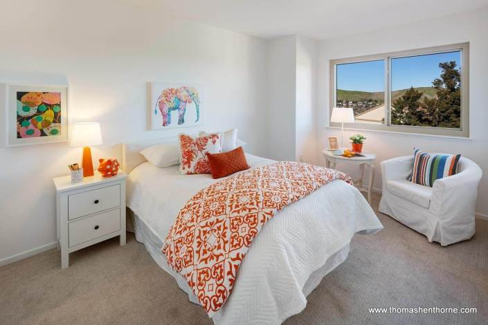 Bedroom with white and orange accents