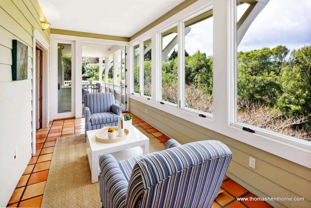Sunroom with striped chairs and French doors