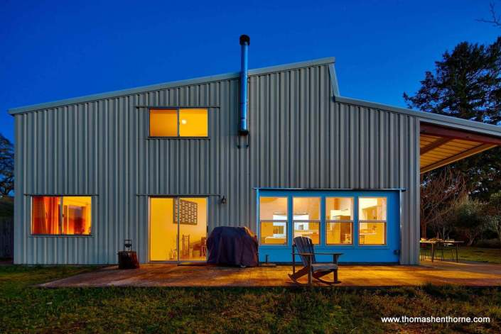 Modern metal industrial home at twilight